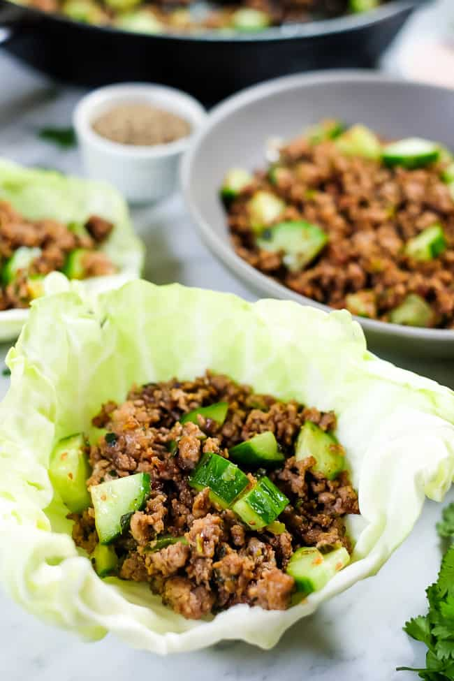 This is a Thai larb recipe with ground pork or chicken, cucumber and some seasonings. Shown served in a cabbage shell.