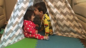 baby toddler preschooler play happy sibling kiss