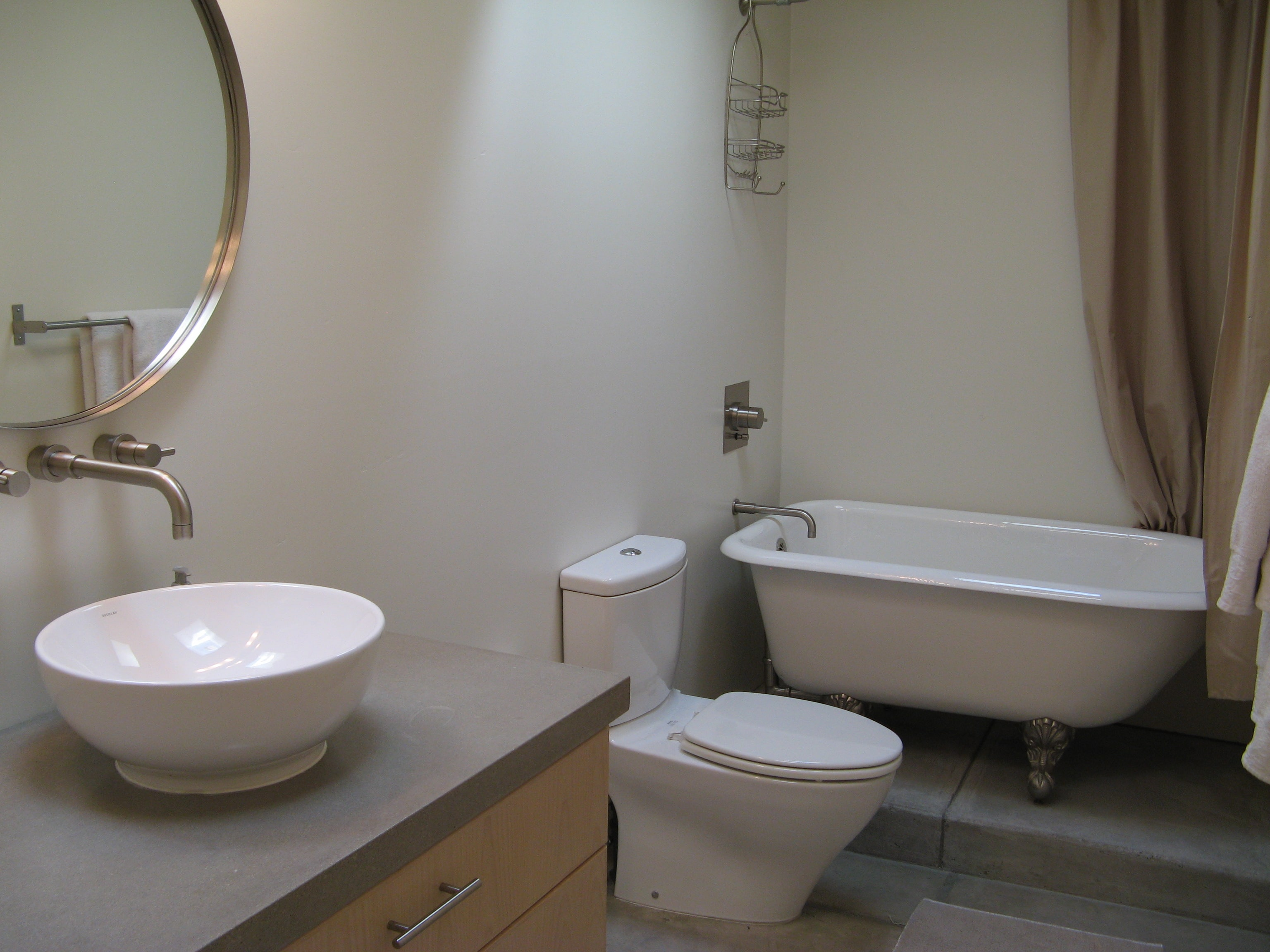 Modern, contemporary fixtures juxtaposed with a vintage claw-foot tub