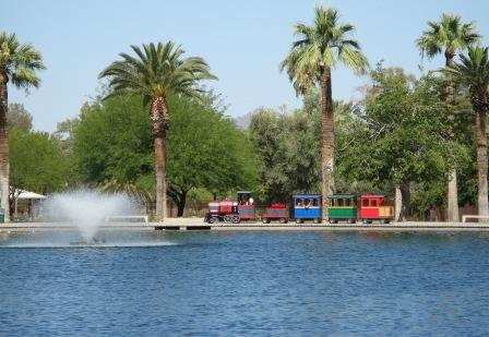 A kid's train ride going around one of the two lakes at Reid Park, located in central Tucson, Arizona.