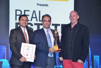Mr. Rajat Rastogi - Executive Director, Runwal Group receiving the 'Most Admired Upcoming Project Of The Year' Award for Runwal Pinnacle