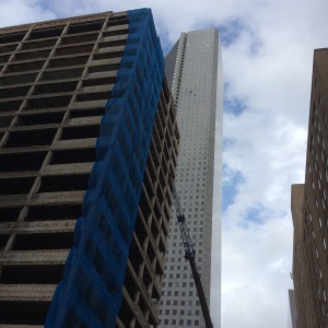The skeleton of the old Houston Club building (left) stands near the 75-story Chase Tower in downtown Houston. The old buildng was imploded Sunday. Photo by Ralph Bivins.