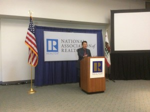 NAR Chief Economist Lawrence Yun speaks at a news conference in San Diego Friday. Photo by Ralph Bivins