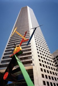 """The 75-story JPMorgan Chase Tower in downtown Houston . The building's plaza features a sculpture by Joan Miró entitled """"Personage and Birds."""""""