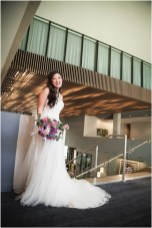 Gown from De la Rosa's Bridal & Tuxedos; Necklace and earrings from Macy's; Bouquet by Curious Floral; Hair by Halo Salon & Day Spa; Makeup by Happily Beautiful Makeup Artistry & Skin Studio; Photography by 2 Girls 20 Cameras on location at Kimpton Sawyer Hotel.
