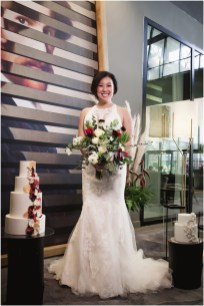 Gown from De la Rosa's Bridal & Tuxedos; Earrings by Sorrelli Jewelry; Bouquet by Placerville Flowers on Main; Hair by Halo Salon & Day Spa; Makeup by Happily Beautiful Makeup Artistry & Skin Studio; Photography by 2 Girls 20 Cameras on location at Kimpton Sawyer Hotel.