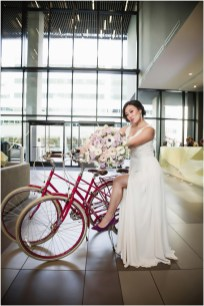 Gown by Vasylkov Bridal Couture from Diamond Bridal Gallery; Earrings by Chloe + Isabel; Shoes from DSW; Bouquet by Picture Perfect Petals; Hair by Halo Salon & Day Spa; Makeup by Happily Beautiful Makeup Artistry & Skin Studio; Photography by 2 Girls 20 Cameras on location at Kimpton Sawyer Hotel.