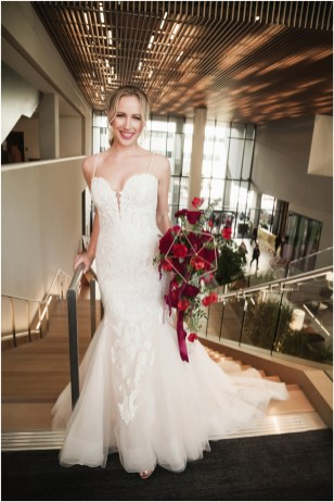 Gown from De la Rosa's Bridal & Tuxedo; Earrings by Style Avenue Studios; Bouquet by Amour Florist; Hair and makeup by All Dolled Up Hair and Makeup Artistry; Photo by 2 Girls 20 Cameras, on location at Kimpton Sawyer Hotel