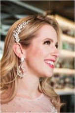 Gown from My Martha Design Boutique; Headpiece and earrings by Twigs & Honey; Bouquet by Carson Valley Florist; Hair and makeup by All Dolled Up Hair and Makeup Artistry; Photo by 2 Girls 20 Cameras, on location at Kimpton Sawyer Hotel