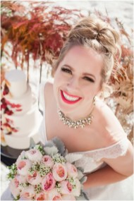 Gown by Solo Merav from Diamond Bridal Gallery; Jewelry by Sorrelli Jewelry; Bouquet by Wild Flowers Design Group; Hair and makeup by All Dolled Up Hair and Makeup Artistry; Photo by 2 Girls 20 Cameras, on location at Kimpton Sawyer Hotel