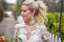 Gown from Second Summer Bride; Earrings by Twigs & Honey; Boots by Ariat; Bouquet by Flourish; Hair by Lisa Harter Hair and Makeup Artist; Makeup by Happily Beautiful Makeup Artistry & Skin Studio. Photography by Farrell Photography on location at Hotel Sutter.