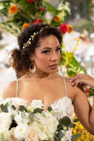 Gown by The Bridal Box; Headpiece by Hair Comes the Bride; Earrings from Macy's; Bouquet by Accents by Sage Floral Design; Hair and makeup by All Dolled Up Hair and Makeup Artistry; Photography by Farrell Photography on location at Hotel Sutter.