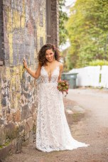 Gown from Always Elegant Bridal & Tuxedo; Earrings from Macy's; Floral hair comb and bouquet by Carson Valley Florist; Hair and makeup by All Dolled Up Hair and Makeup Artistry; Photography by Farrell Photography on location at Hotel Sutter.