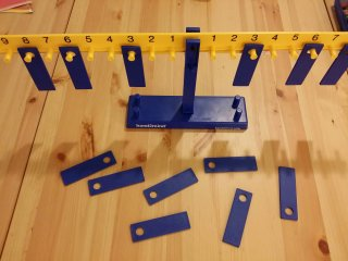 Hands-on math manipulative: a balance beam from the RightStart Curriculum with 10g weights
