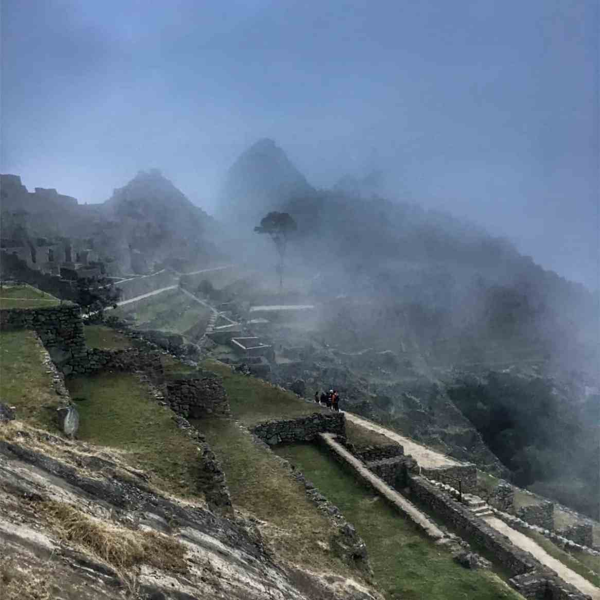 machu picchu buildings with fog