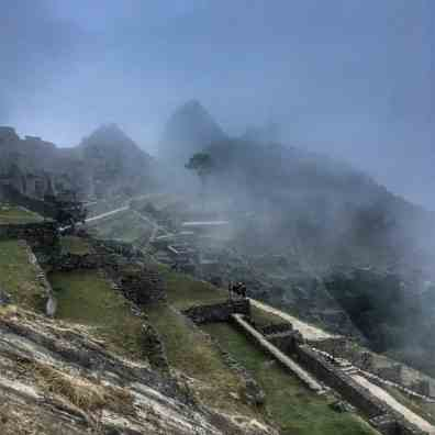machu picchu buildings with fog