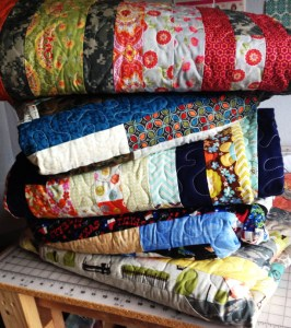 Folded Stacked Military Uniform Quilts