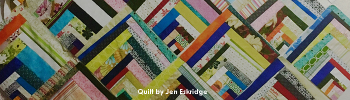 Scrappy Quarter-Square Log Cabin Quilt