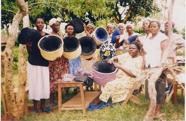 Photo of Women's fellowship group with the fireless cookers they have made