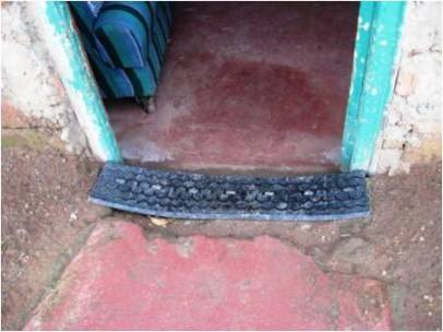 A strip of tyre makes a practical doormat