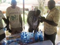 Cutting bottles for making Soap Moulds at Natural Medicines Training Seminar