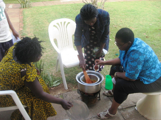 Making honey ointment at Natural Medicines Training Seminar