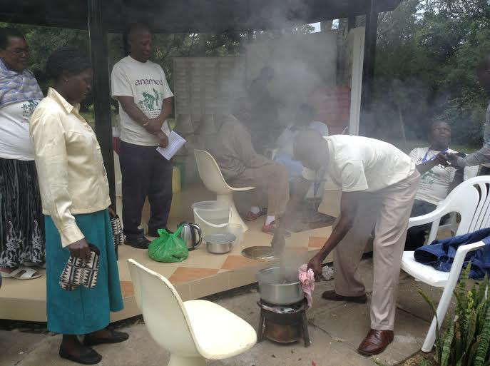 Wilimina teaching on making medicinal charcoal at Natural Medicines Training Seminar