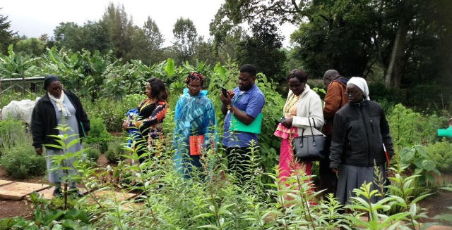 Sr Francisca shows plants in her garden to other participants during the seminar in May 2018
