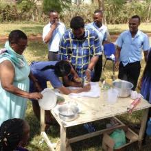 Rosalia supervising the students preparing beeswax for adding to ointments