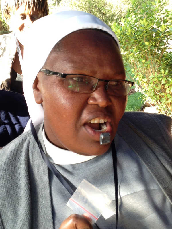 Photo of Sister Francisca testing black stone