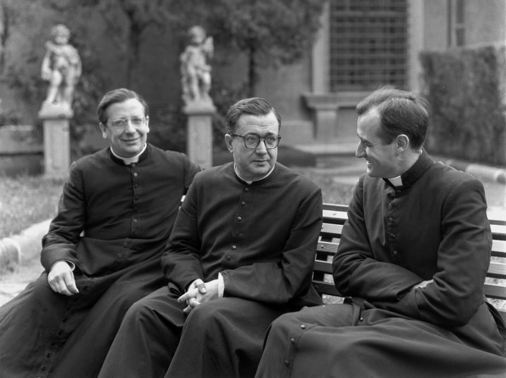 Catholic priests in a garden