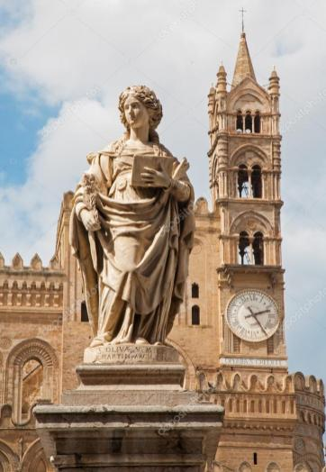 Statue of saint olivia. cathedral in palermo with the clock, sicily. Italy