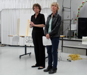 Lisa Mitchell (right) joins Marlene Brown and helps explain to the group what has happened in court so far, and explains why Brown and her neighbours are going back to court to act as interveners in the case between Nova Scotia Environment and the numbered companies for a second time. (Rebecca Hussman)