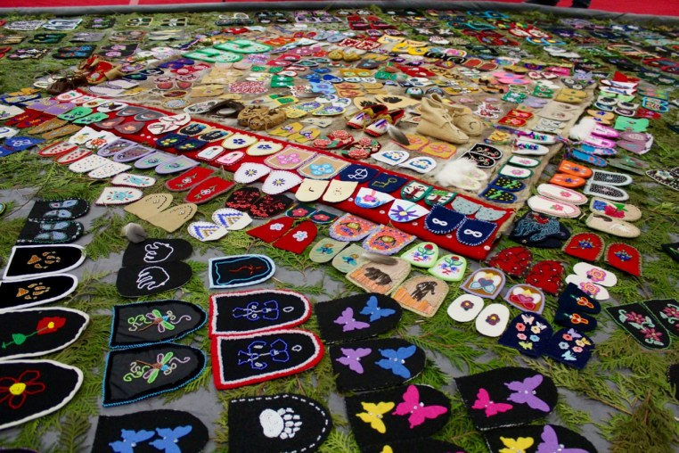 The display of unfinished moccasins, or vamps at the Walking With Our Sisters memorial. (Rebecca Hussman)