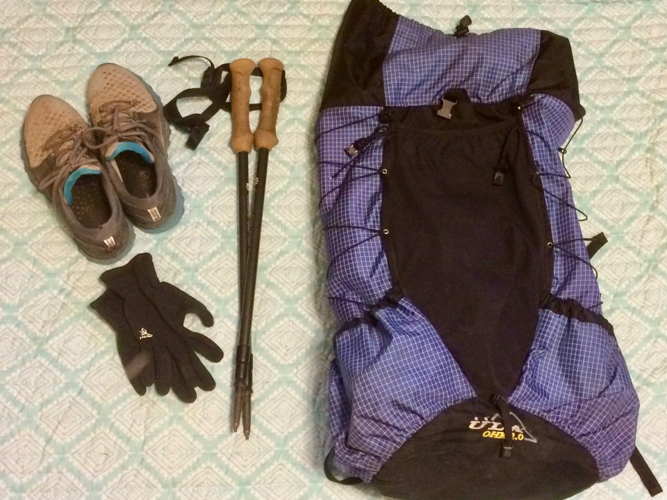Thru-hiking backpack, trekking poles, shoes, and gloves