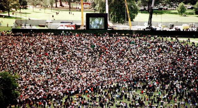 crowd-watches-funeral-giant-video-screen.jpg