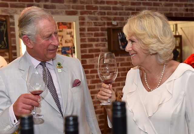 Britain's Prince Charles and Camilla, Duchess of Cornwall sample wines produced at Oranje Tractor Wines in Albany