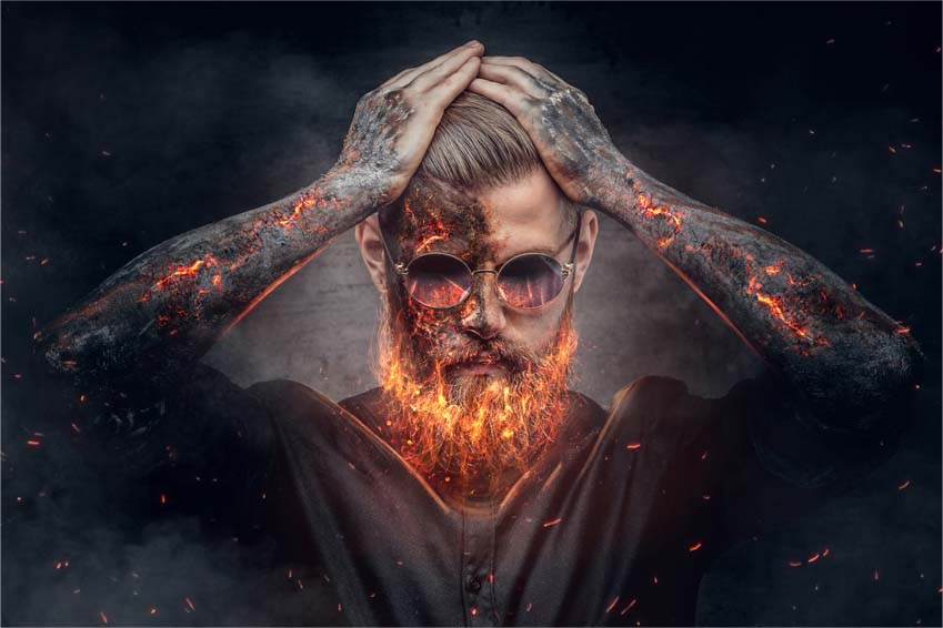 Demonic male with burning beard and arms.