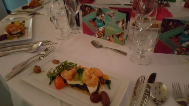 Shrimp Salad with microgreens, heirloom tomatoes, pesto and puff pastry.
