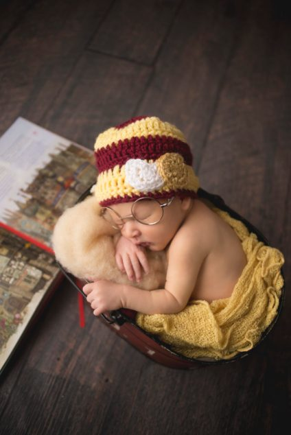 baby with Harry Potter props