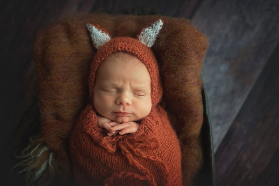 newborn photography with cute props