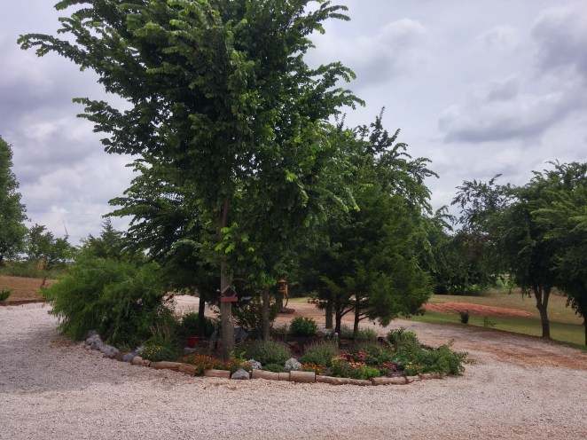 Beautiful garden in the middle of the circle drive.