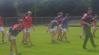 Rebel Óg u16 football squad in @KilmurryGAA earlier today warming down with Derek Kavanagh