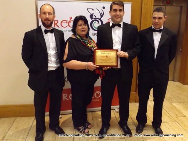 Benchmarking 2020 Ursula Coleman Killeagh GAA Club accepting the Gold Accreditation 2016 Benchmarking 2020 Award from GDA Sean Crowley with Kevin O'Donovan Coaching Officer & Kevin O Callaghan Games Manager