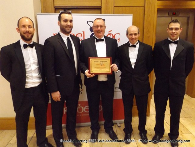 Benchmarking 2020 Paul Barry & Padraig Tracey Nemo Rangers GAA Club accepting the Gold Accreditation 2016 Benchmarking 2020 Award from GDA Colm Crowley with Kevin O'Donovan Coaching Officer & Kevin O Callaghan Games Manager