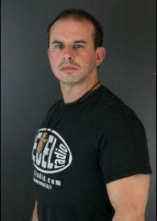 Andy Gehron, wearing a Rebel Radio T-shirt