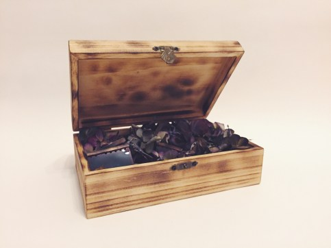 Burnt box filled with dried flowers and film negatives