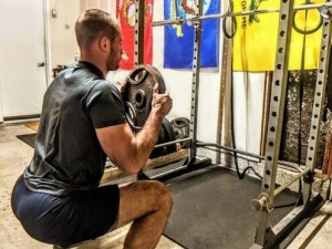 Picture of Coach T Demonstrating a goblet squat