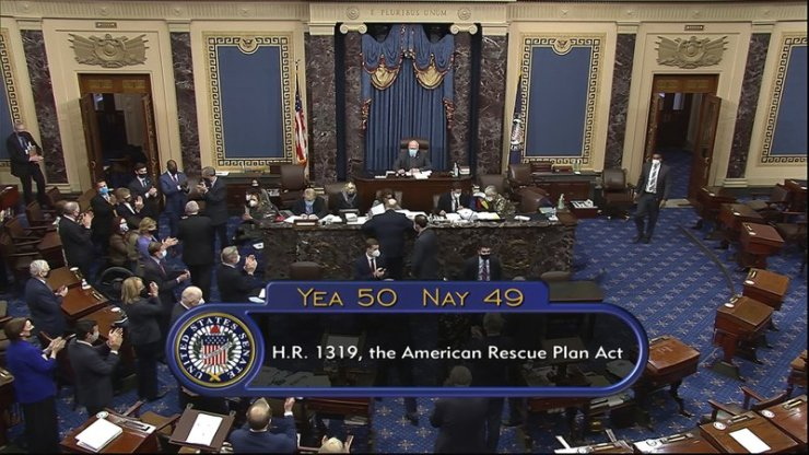 As the Senate approves a $1.9 trillion virus relief package, Biden and the Democrats triumph.