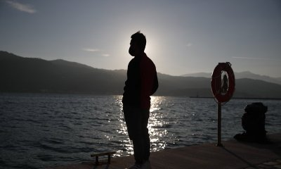 A migrant father has been charged with his son's death while traveling to Greece.